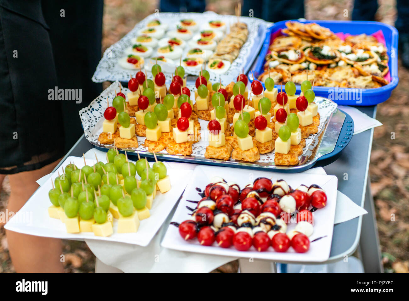 buffet Assortment of canapes. Banquet service. catering food, snacks with mixed fingerfood appetizers. - Stock Image