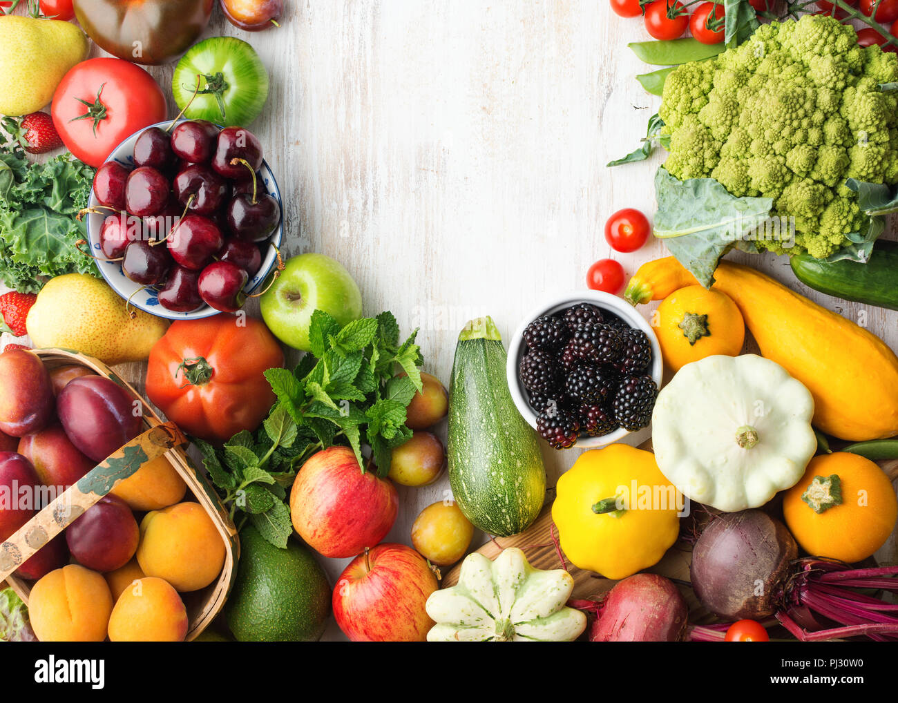 Healthy eating, summer fruits vegetables berries, cherries peaches broccoli squash tomatoes plums beans beetroot, copy space, top view, selective focus Stock Photo