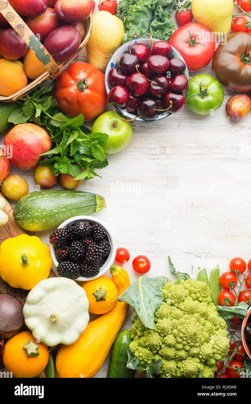 Healthy eating, summer fruits vegetables berries, cherries peaches broccoli squash tomatoes plums beans beetroot, copy space, top view, vertical, selective focus Stock Photo
