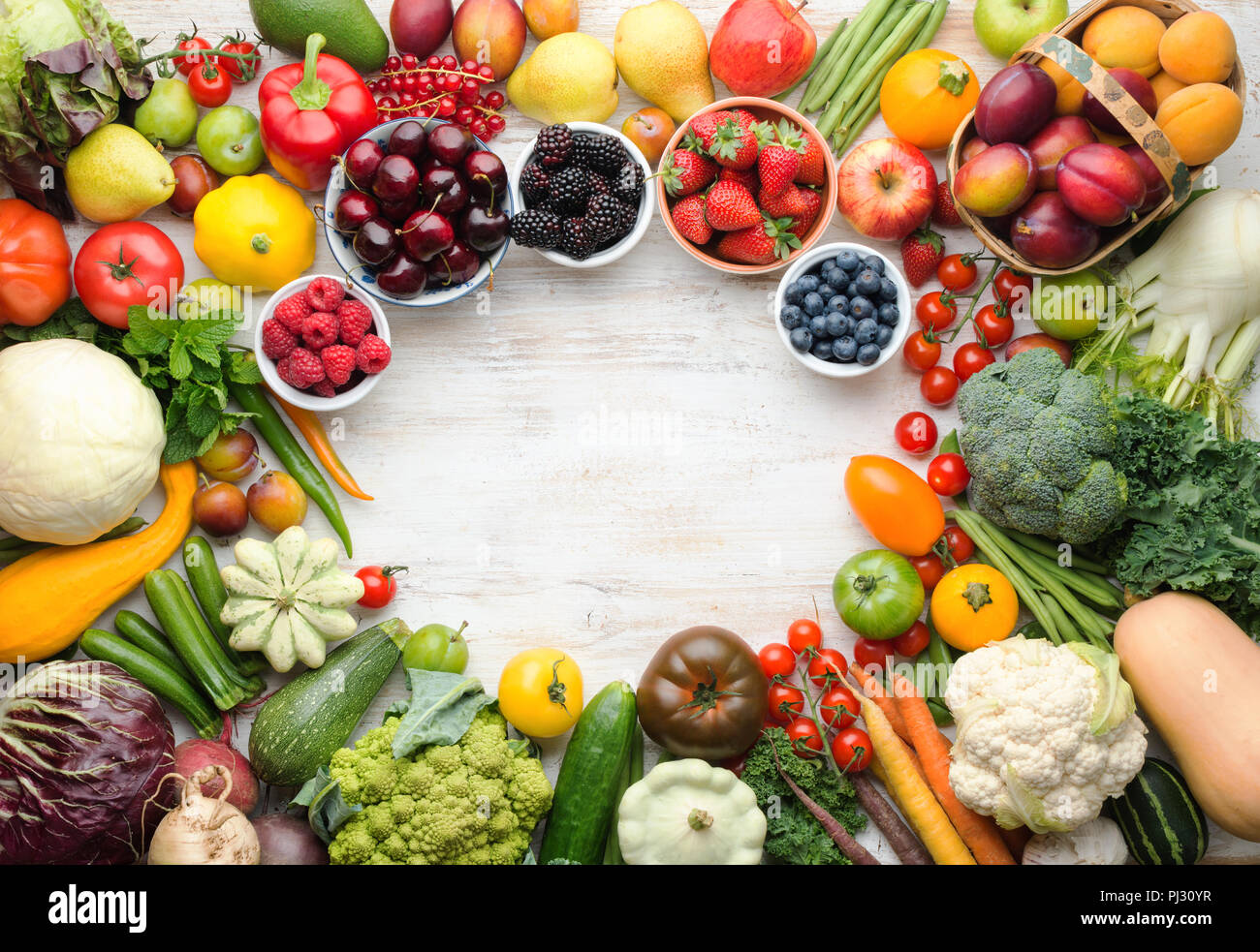 Fresh summer fruits vegetables berries background, cherries peaches strawberries cabbage broccoli cauliflower squash tomatoes carrots beans beetroot, pepper, top view, selective focus Stock Photo