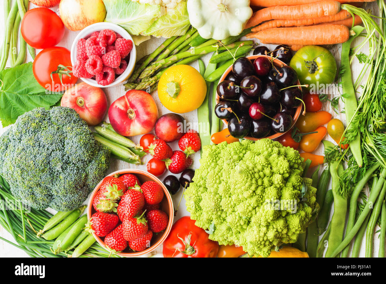 Summer fruits vegetables berries background, apples cherries peaches strawberries cabbage broccoli cauliflower squash tomatoes carrots spring beetroot, copy space, top view, selective focus Stock Photo