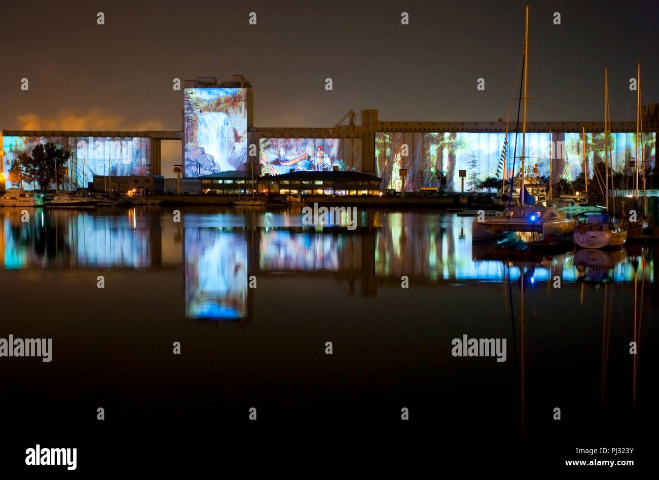 North America, Canada, Quebec, Quebec City, The Image Mill light show projected on the Old Port grain elevators - Stock Image