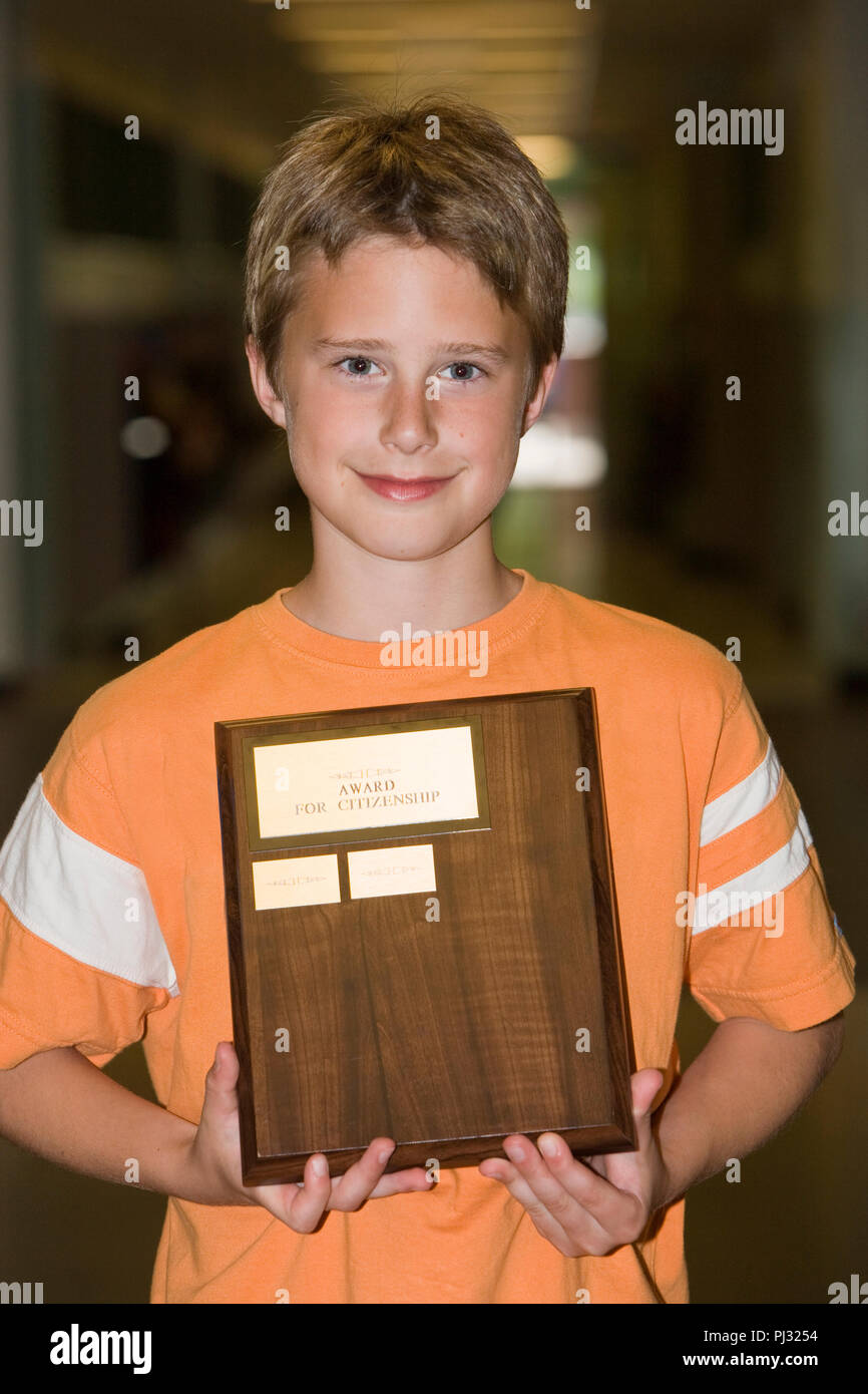 boy holding citizenship award - Stock Image