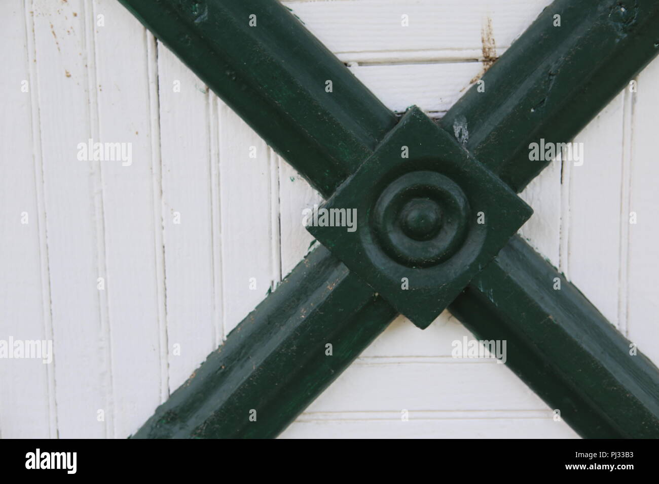 structural metal piece on old farm building - Stock Image