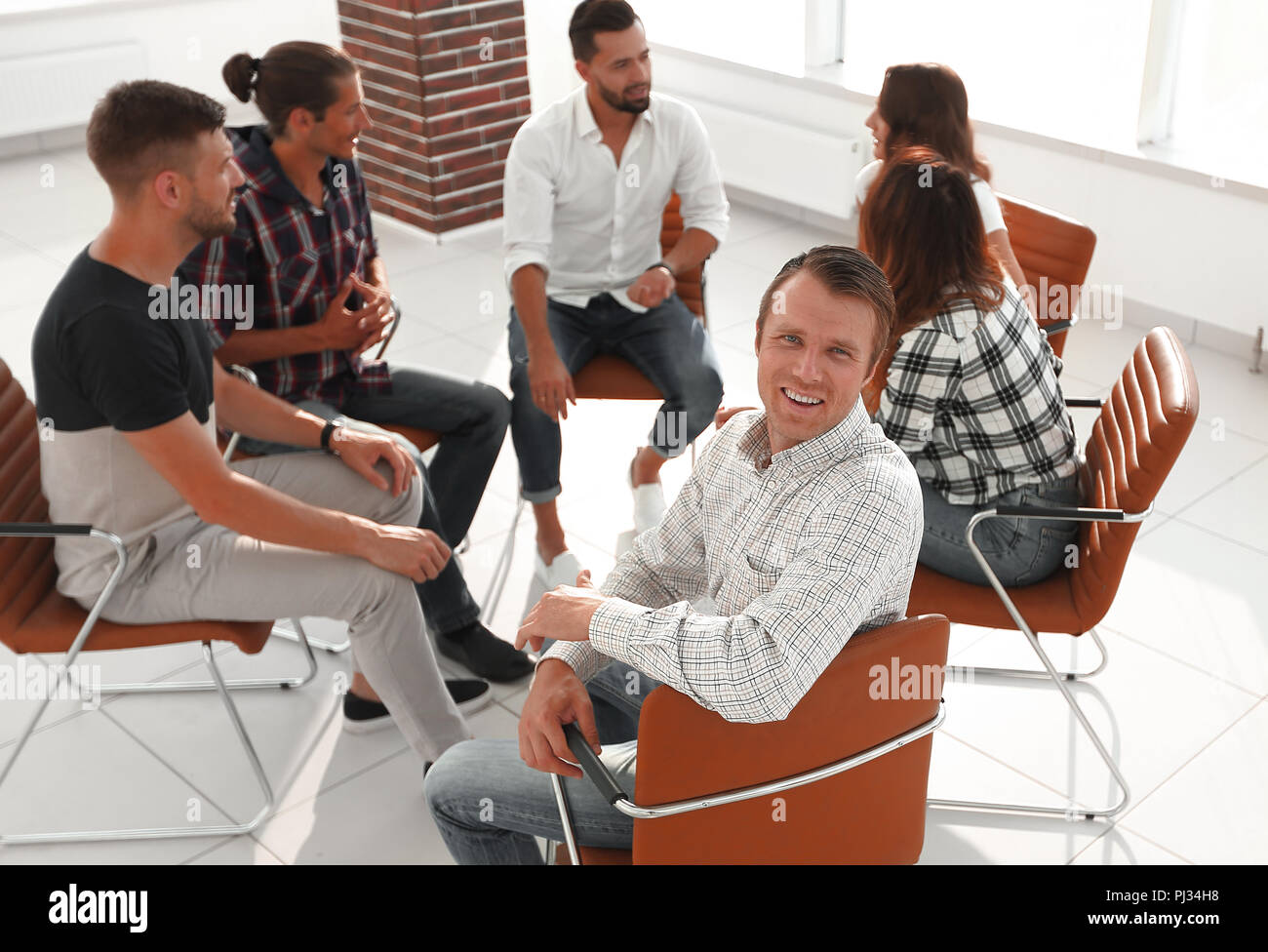 confident Manager , sitting at the workshop - Stock Image