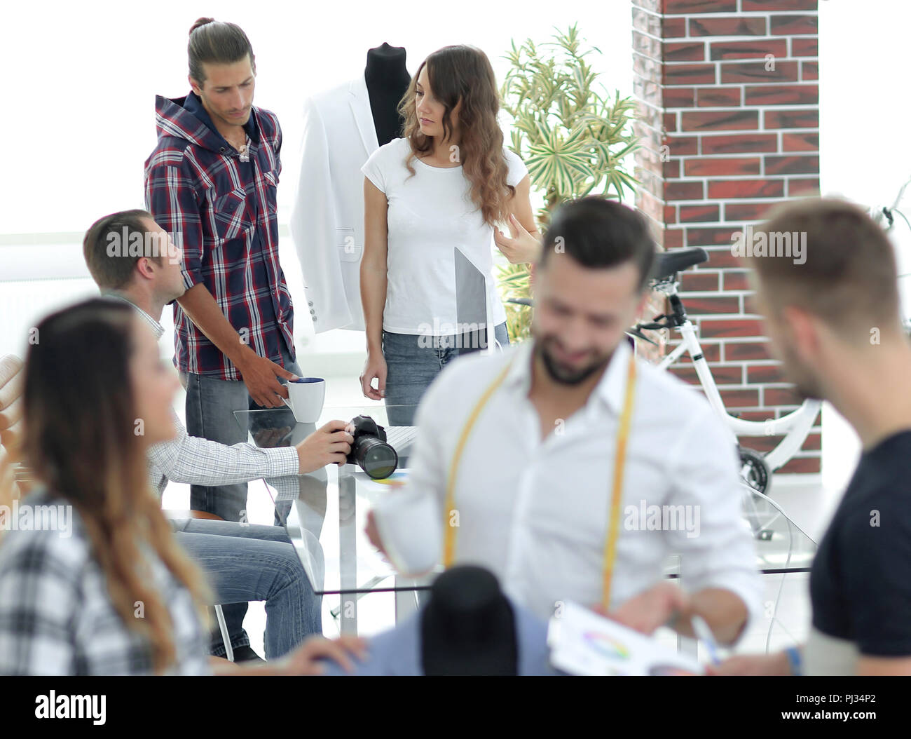 young designers discussing male costume - Stock Image