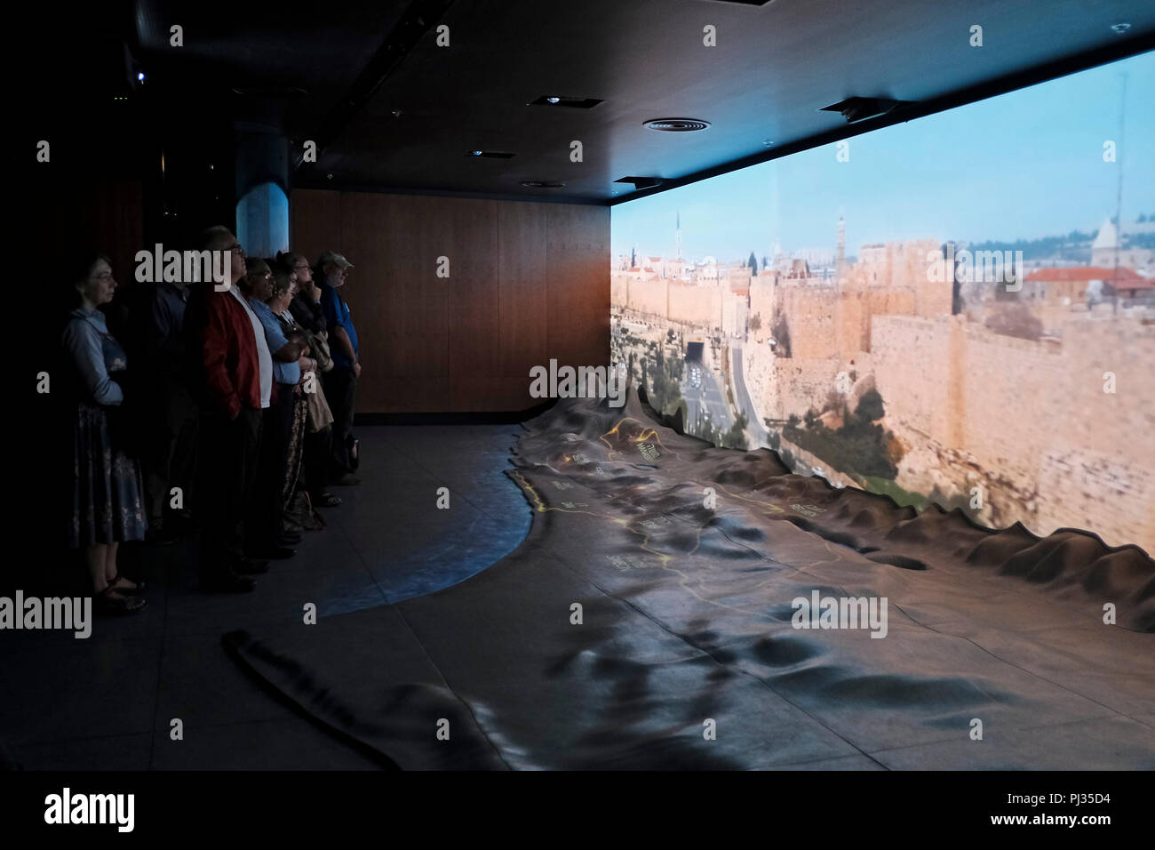 Visitors watching an audio visual show inside the friends of zion museum which tell the story