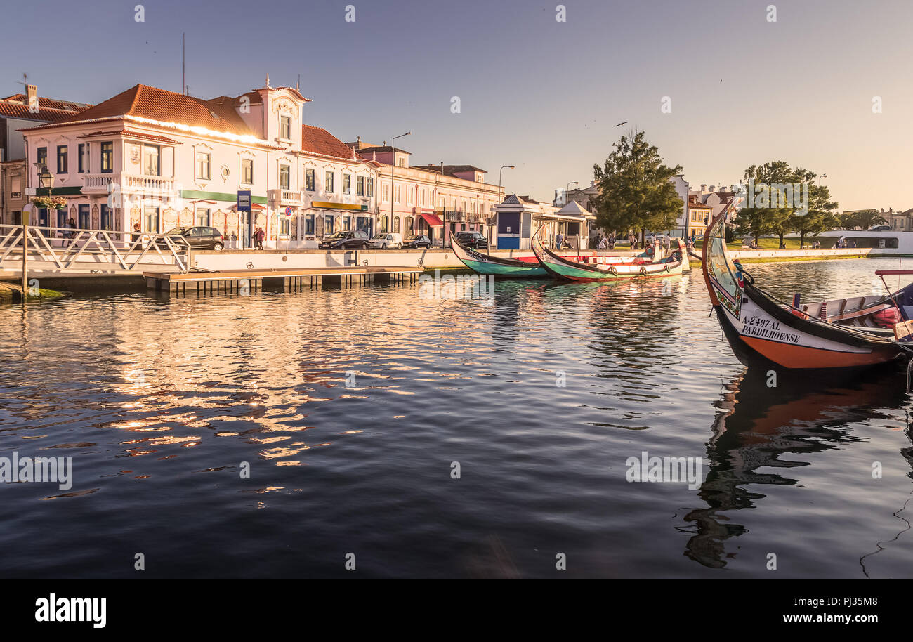 Central canal in Aveiro, Portugal, with some traditional boats, known as moliceiros and old houses of background. - Stock Image