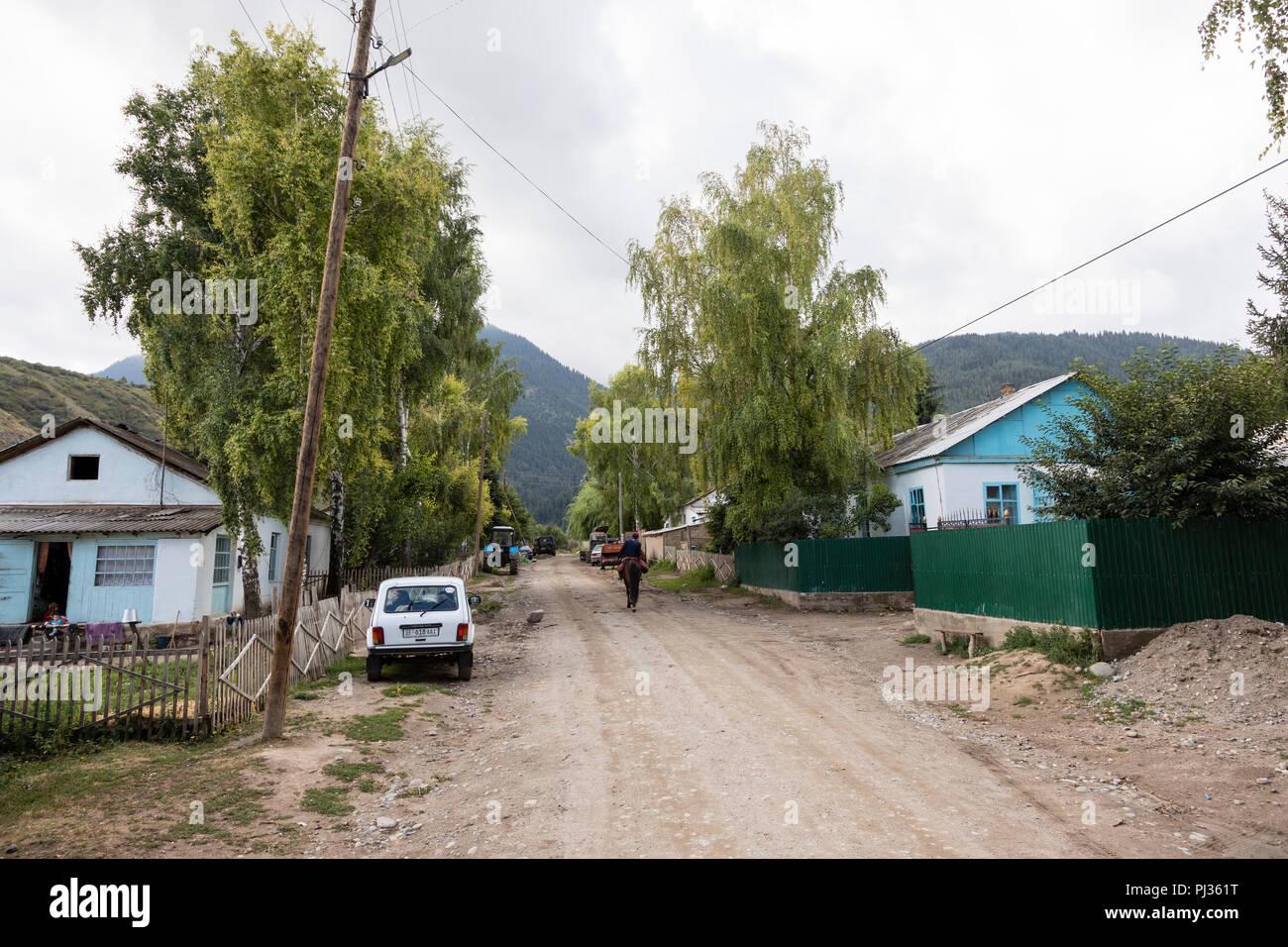 Altyn-Arashan, Kyrgyzstan, August 13 2018: Horse trek in the valley of Alty-Arashan near Karakol - Stock Image