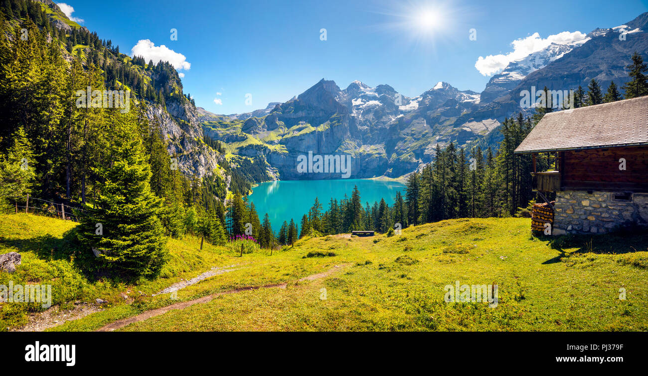 Colorful summer morning on unique lake - Oeschinen (Oeschinensee), UNESCO World Heritage Site. Switzerland, Europe - Stock Image