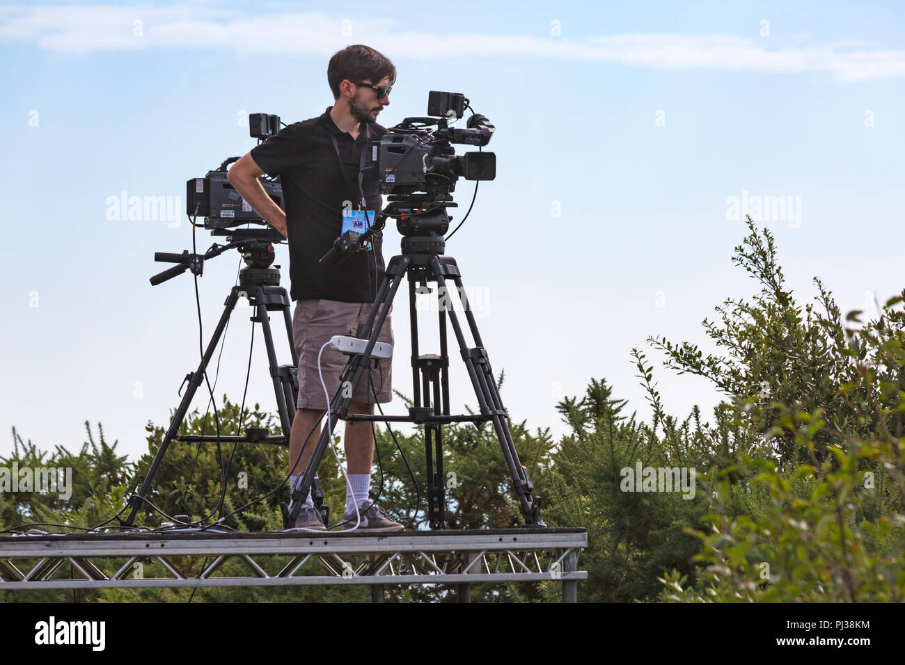 TV camera man with cameras at Bournemouth Air Festival, Bournemouth, Dorset UK in September - Stock Image