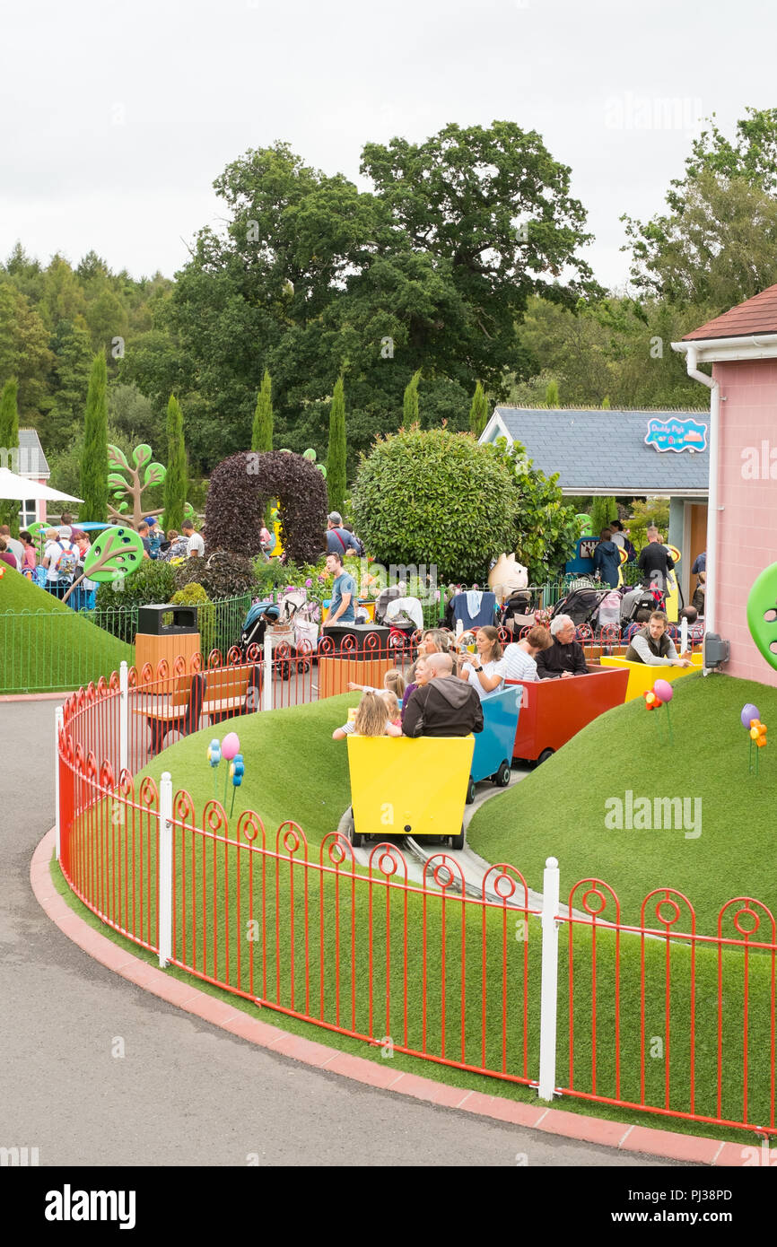 Grandpa Pig's little train ride, Peppa pig world, Paultons park, Romsey, Southampton, England, United Kingdom. - Stock Image