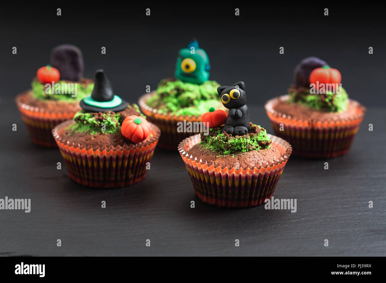 Fondant Halloween Decorations.Halloween Holiday Food Colorful Fancy Brownies Cupcake With Fondant Decorate Stock Photo Alamy