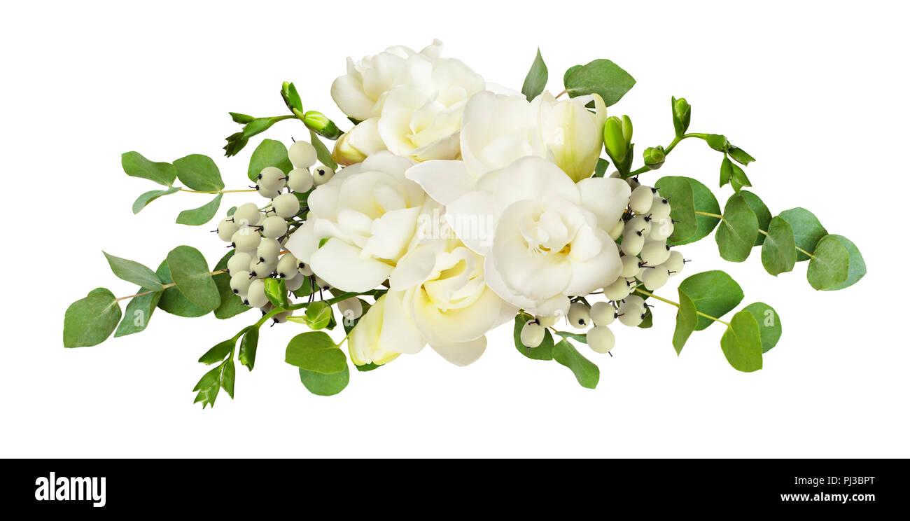 Fresh White Freesia Flowers And Eucalyptus Leaves In Arrangement
