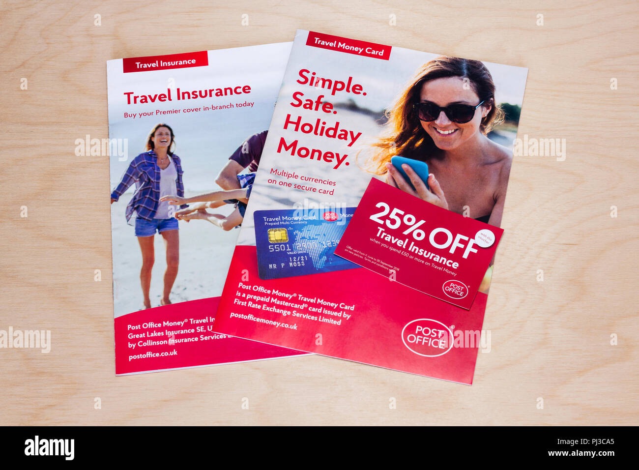 Travel insurance and holiday money leaflets from a UK post office - Stock Image