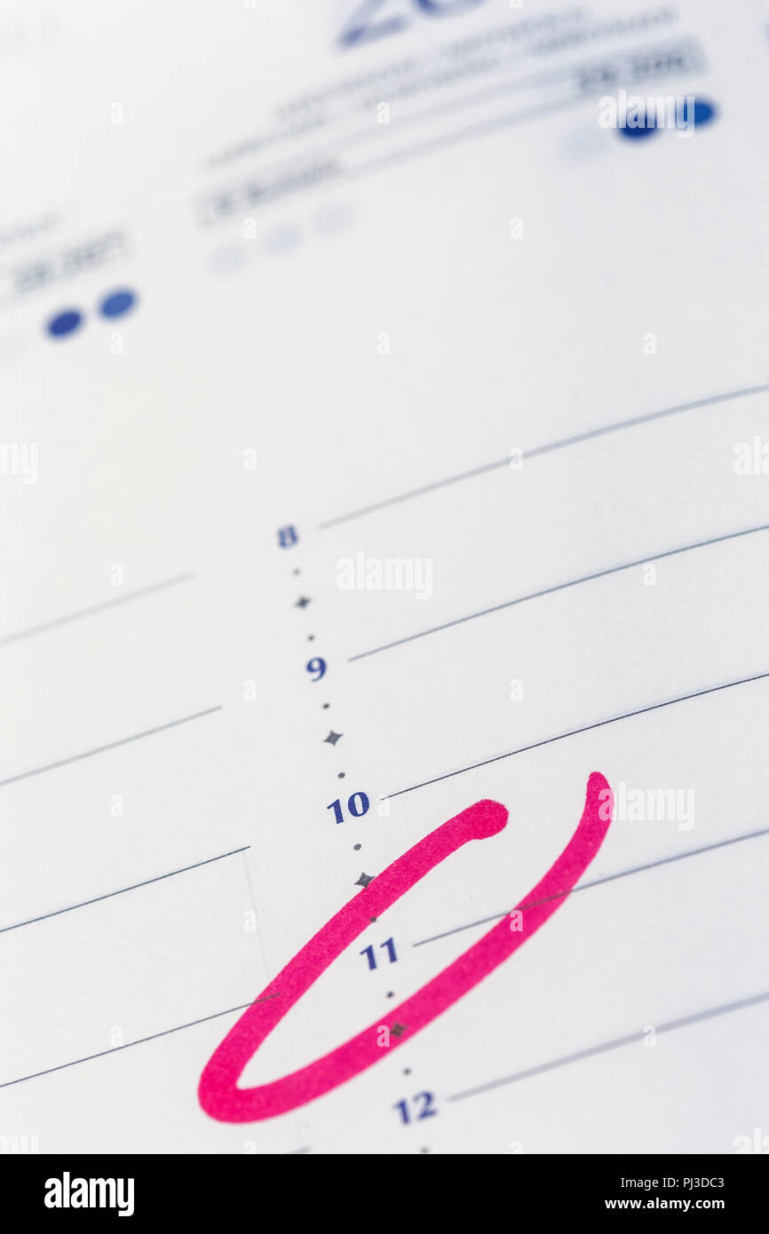 Calendar Planning An Hour Circled In Pink Marker To Remind