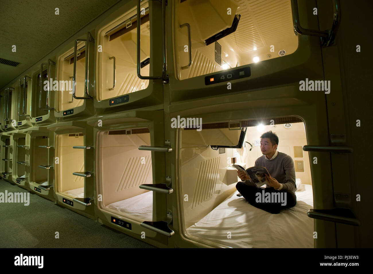 Photo shows the sleeping berths offered at SkySpa relaxation resort and capsule hotel in Yokohama, Japan on 03 Feb. 2012. Capsule hotels can be found  - Stock Image