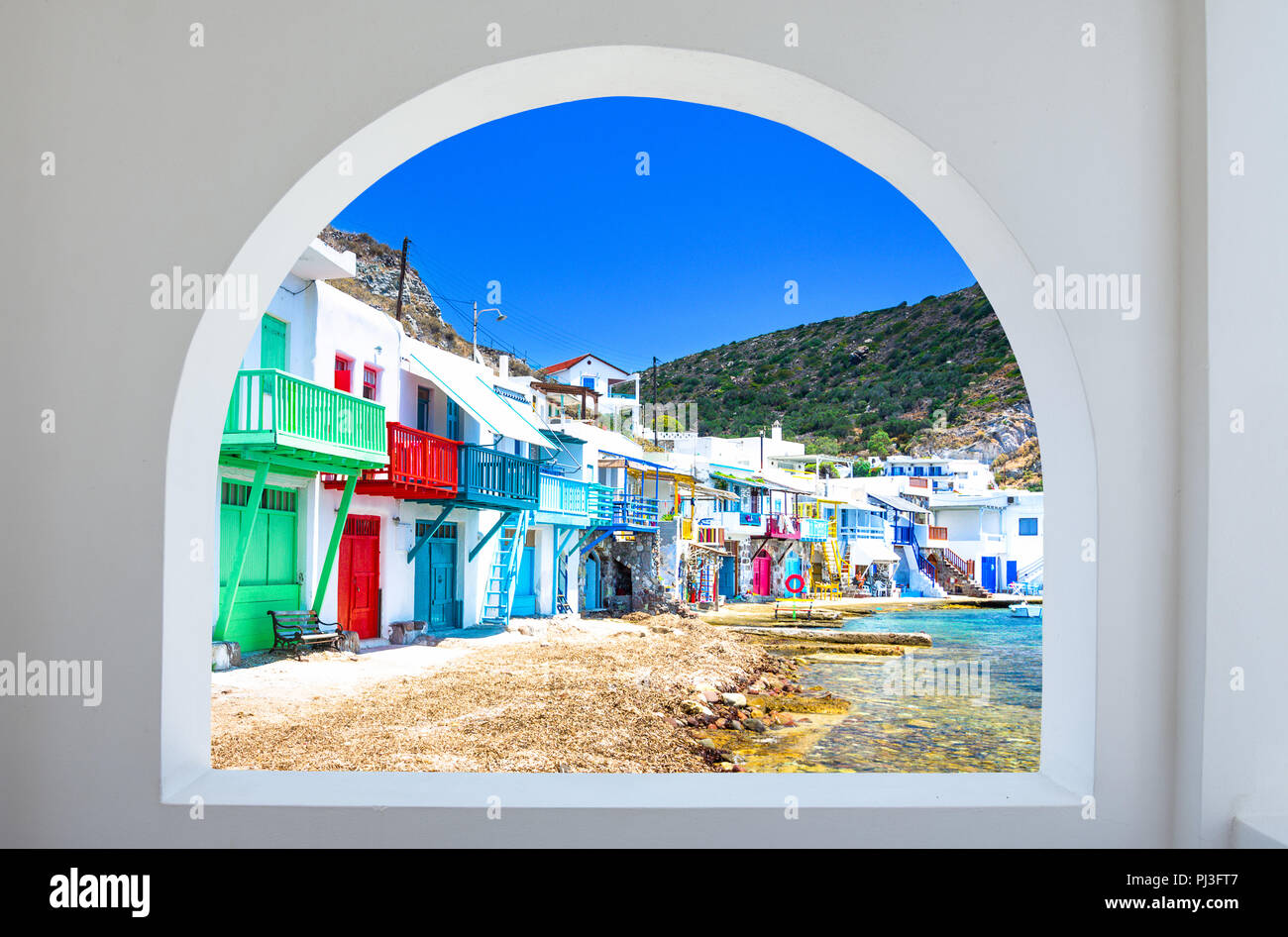 Klima village (traditional Greek village by the sea, the Cycladic-style) with sirmata - traditional fishermen's houses, Milos island, Cyclades, Greece - Stock Image