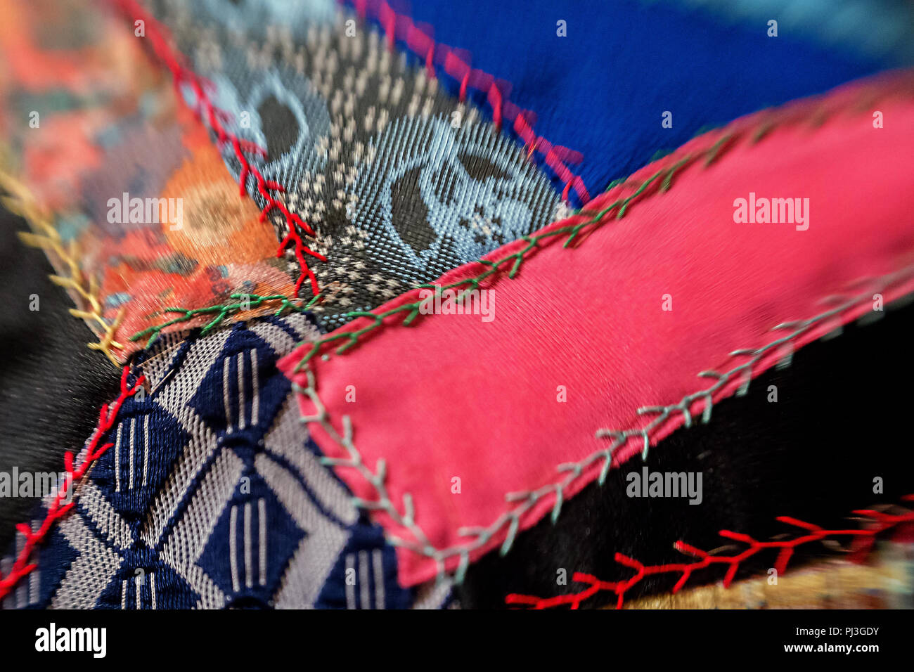 closeup of vintage sewn quilt - Stock Image