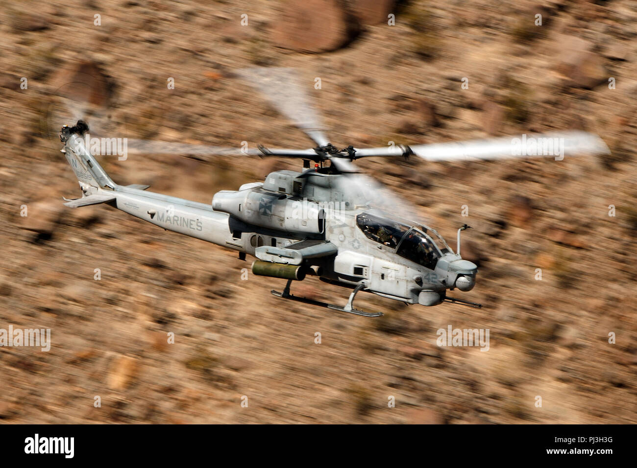 United States Marines Corps Bell AH-1Z Viper (SN 168519) from the  Marine Light Attack Helicopter Squadron 169 (HMLA-169) flies low level on the Jedi Transition through Star Wars Canyon / Rainbow Canyon, Death Valley National Park, Panamint Springs, California, United States of America Stock Photo