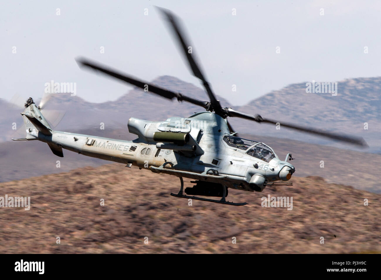 United States Marines Corps Bell AH-1Z Viper (SN 168529) flies low level on the Jedi Transition through Star Wars Canyon / Rainbow Canyon, Death Valley National Park, Panamint Springs, California, United States of America - Stock Image
