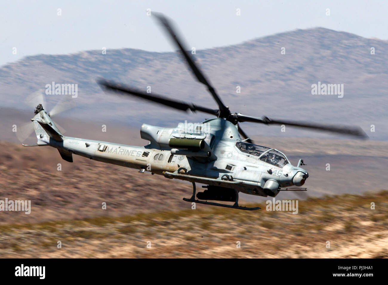 United States Marines Corps Bell AH-1Z Viper (SN 168529) flies low level on the Jedi Transition through Star Wars Canyon / Rainbow Canyon, Death Valley National Park, Panamint Springs, California, United States of America Stock Photo