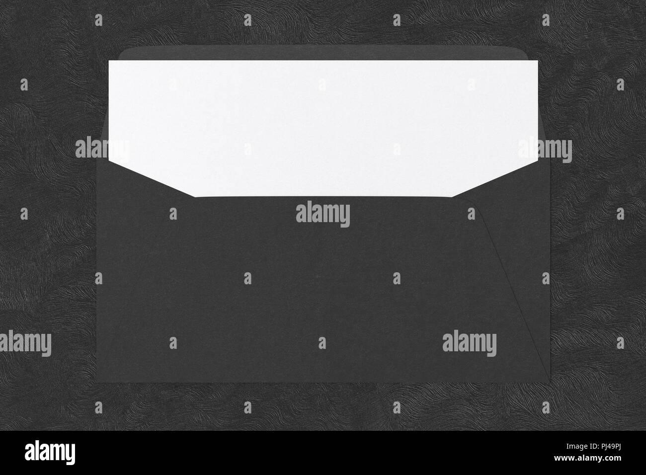 black blank envelope with blank letter inside on black background
