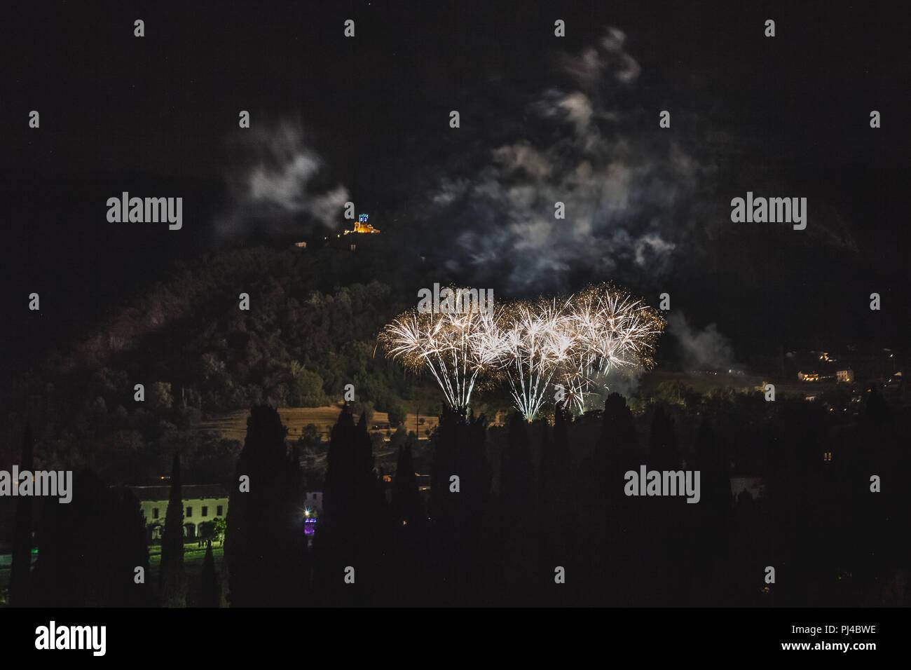 fireworks with illuminated church of the patron saint of the city background vittorio veneto italy