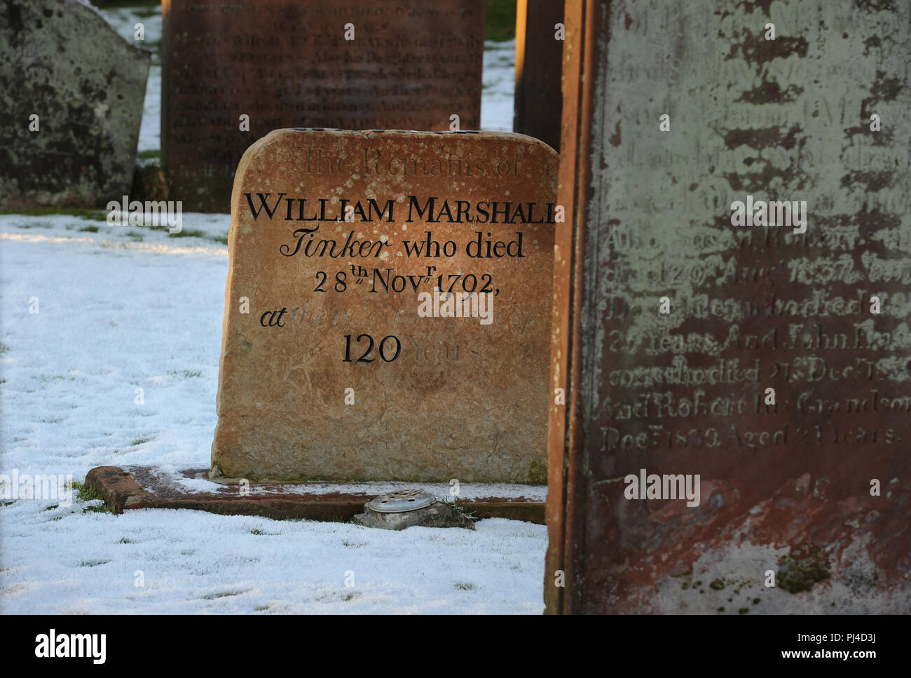 Winter snow the grave of tinker William Marshall, said to be 120 years old when he died - Kirkcudbright graveyard, Dumfries and Galloway., SW Scotland - Stock Image