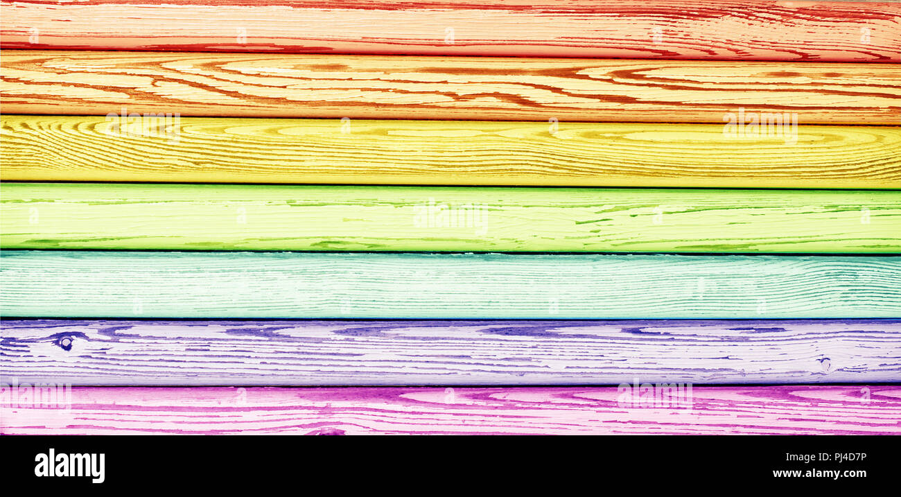 Old wooden texture in rainbow colors. Colorful grunge background Stock Photo