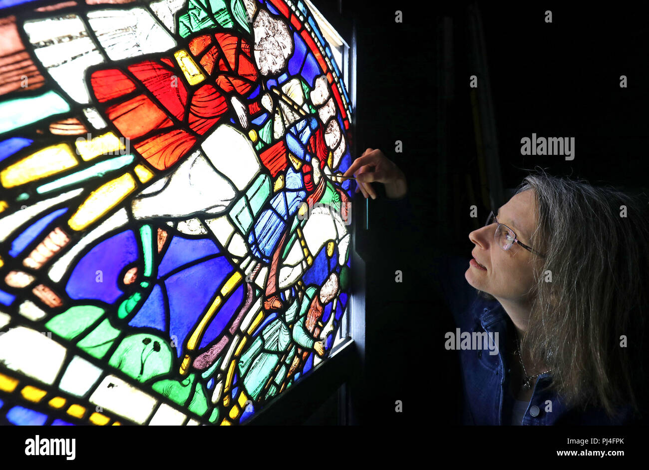Dr. Rachel Koopmans, Associate Professor of History at York University in Toronto, views stained glass panels at Canterbury Cathedral in Kent, which were previously thought to be the work of Victorian restorers but have been found to date to the late 12th century, making them the earliest known art works depicting pilgrims travelling to Canterbury. - Stock Image