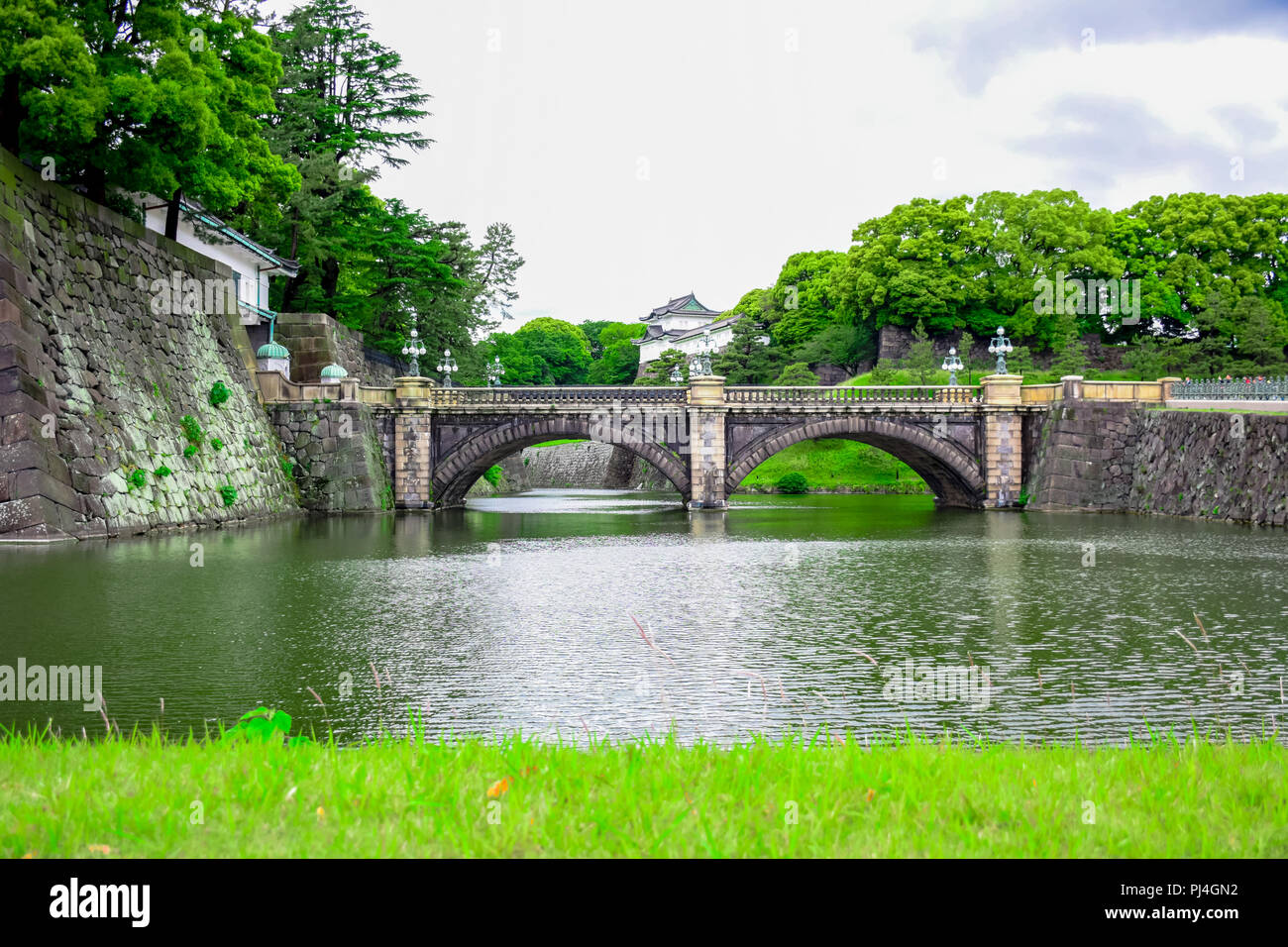 Seimon Ishibashi (Nijubashi) Bridge, the Tokyo's most famous bridge at the Imperial Palace in Tokyo, Japan - Stock Image