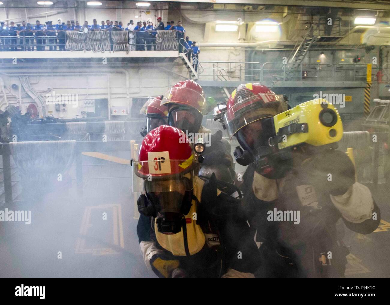 180826-N-PH222-0462 TRINCOMALEE, SRI LANKA (August 26, 2018) Sailors aboard San Antonio-class amphibious transport dock USS Anchorage (LPD 23) demonstrate fire-fighting techniques in the well deck to the Sri Lanka navy sailors during a regularly scheduled deployment of the Essex Amphibious Ready Group (ARG) and the 13th Marine Expeditionary Unit (MEU). Anchorage and the embarked Marines of the 13th MEU are conducting a theater security cooperation exercise with the Sri Lankan navy and Marines. Part of a growing U.S.-Sri Lanka naval partnership, the exercise is also an opportunity for U.S. Seve - Stock Image