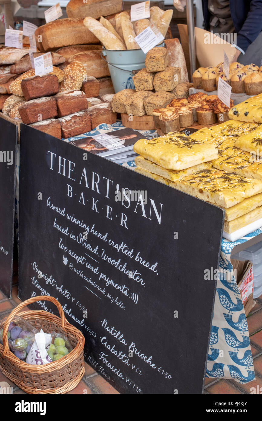 The Artisan Baker stall at a farmers market. Stroud, Gloucestershire, England - Stock Image