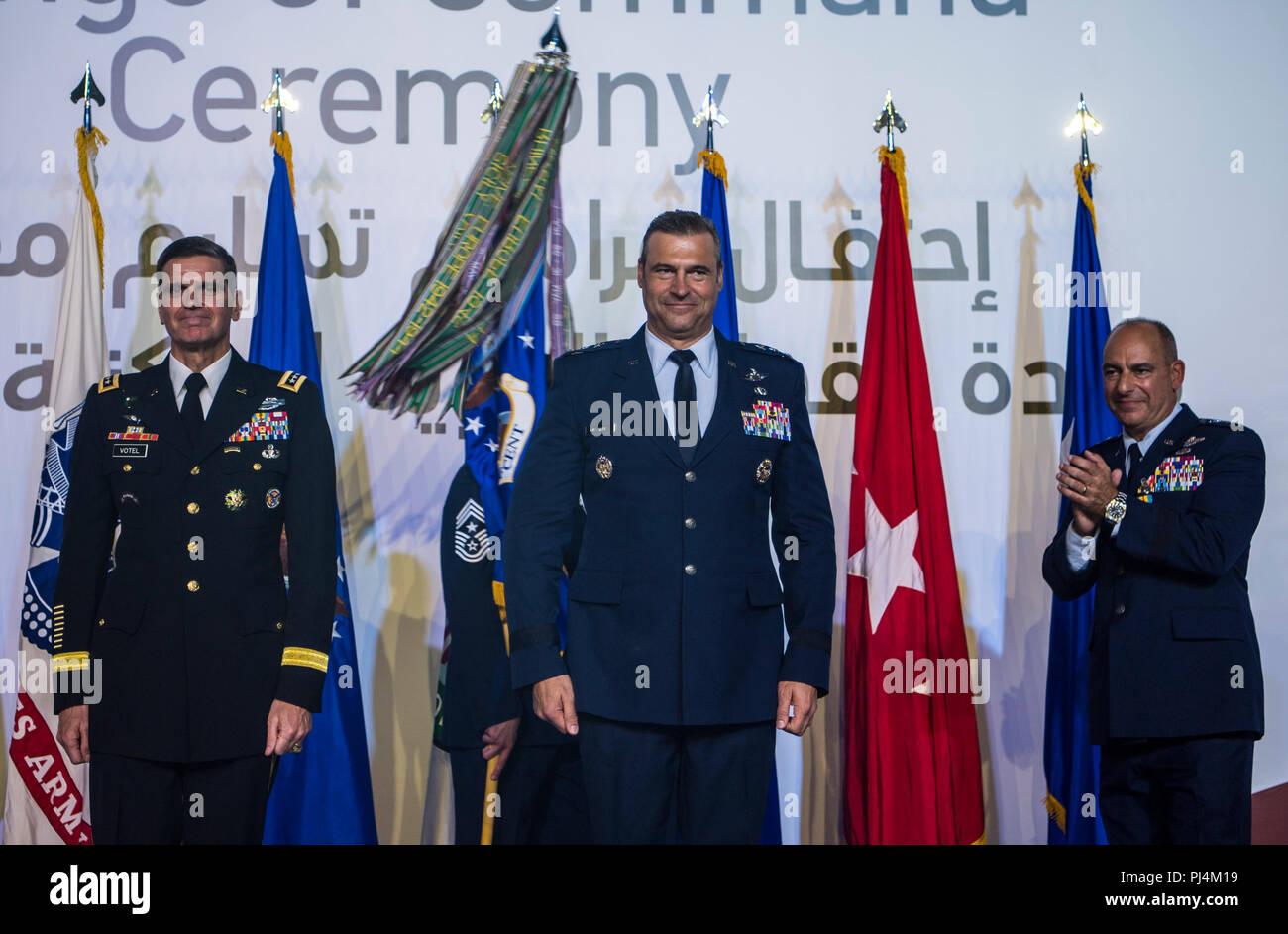 U.S. Army Gen. Joseph L. Votel, Commander of U.S. Central Command (CENTCOM), stands with U.S. Air Force Lt. Gen. Joseph T. Guastella Jr., Commander of U.S. Air Forces Central Command (AFCENT), and Air Force Lt. Gen. Jeffrey L. Harrigian, outgoing AFCENT commander, during a change of command ceremony at Al Udeid Air Base, Qatar, Aug. 30, 2018. Guastella entered the Air Force in 1987 as a graduate of the U.S. Air Force Academy. He has flown the F-16 Fighting Falcon and A-10 Thunderbolt II, served as the wing commander of the 455th Air Expeditionary Wing at Bagram Airfield, Afghanistan, has had m Stock Photo