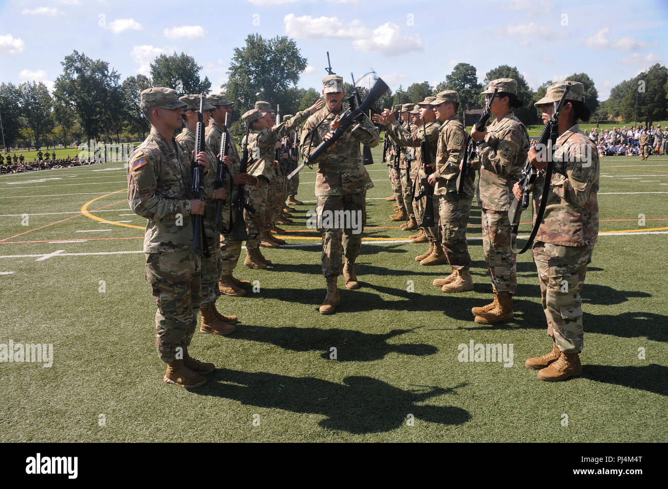 A platoon leader twirls his weapon while marching through opposing ranks of Soldiers who completed weapon tosses to each other as he passed through during the 23rd Quartermaster Brigade Drill and Ceremony Competition Aug. 23 at Fort Lee. Stock Photo