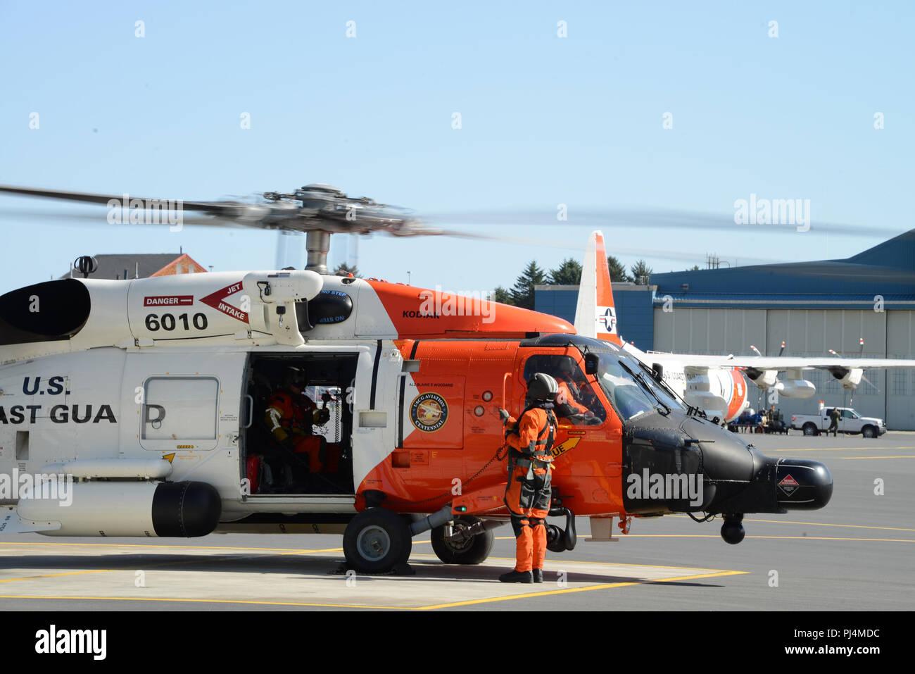 A Coast Guard Air Station Kodiak MH-60 Jayhawk aircrew