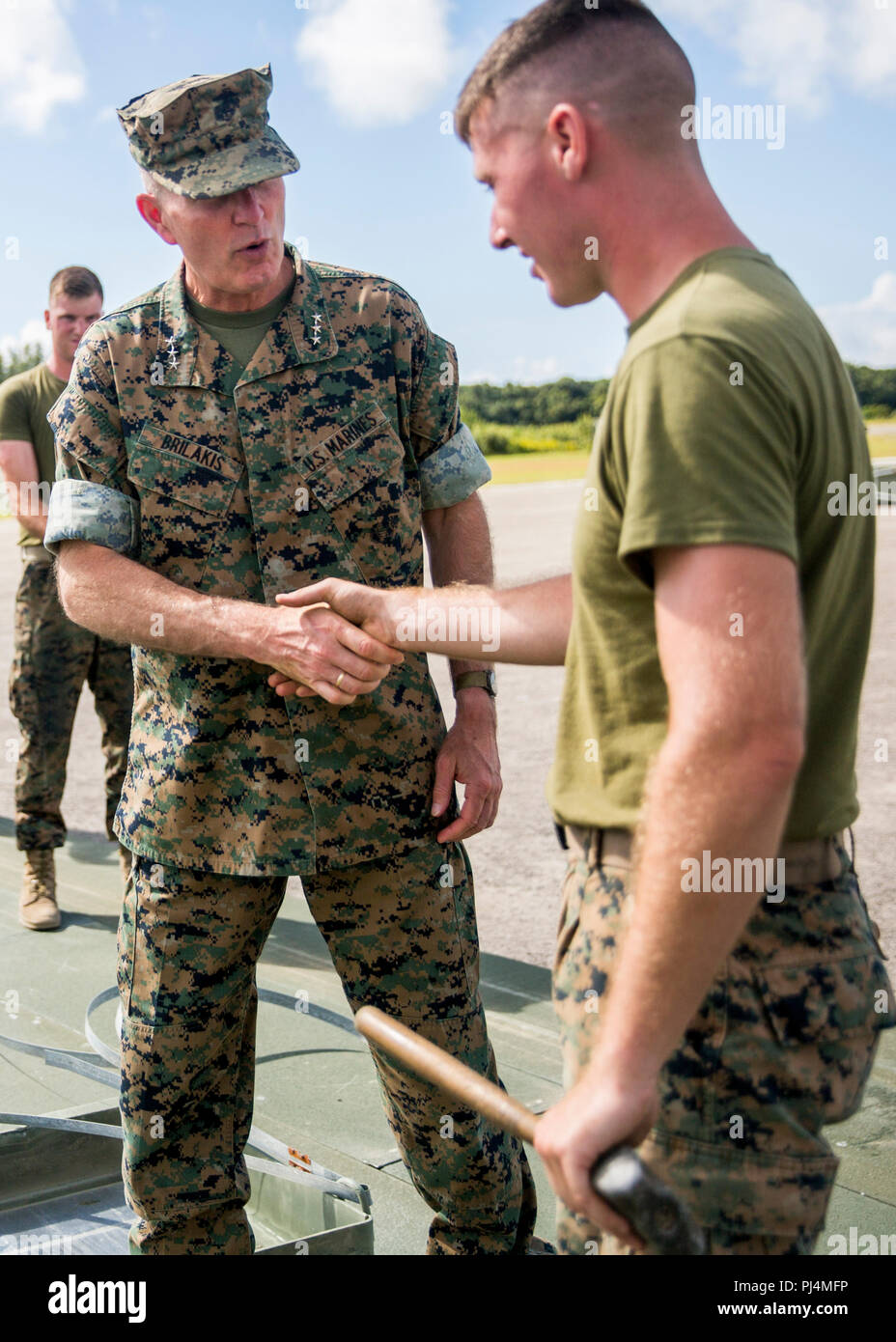 U.S. Marine Corps Lt.Gen. Mark A. Brilakis speaks to a Marine with Marine Wing Support Squadron 272 during his visitation on Marine Corps Auxiliary Landing Field Bogue, August 28, 2018. Lt.Gen. Brilakis visited the 2nd Marine Aircraft Wing (2d MAW) in order to orient himself on the current status of 2d Maw. Brilakis is the commanding general of Marine Forces Command. Stock Photo