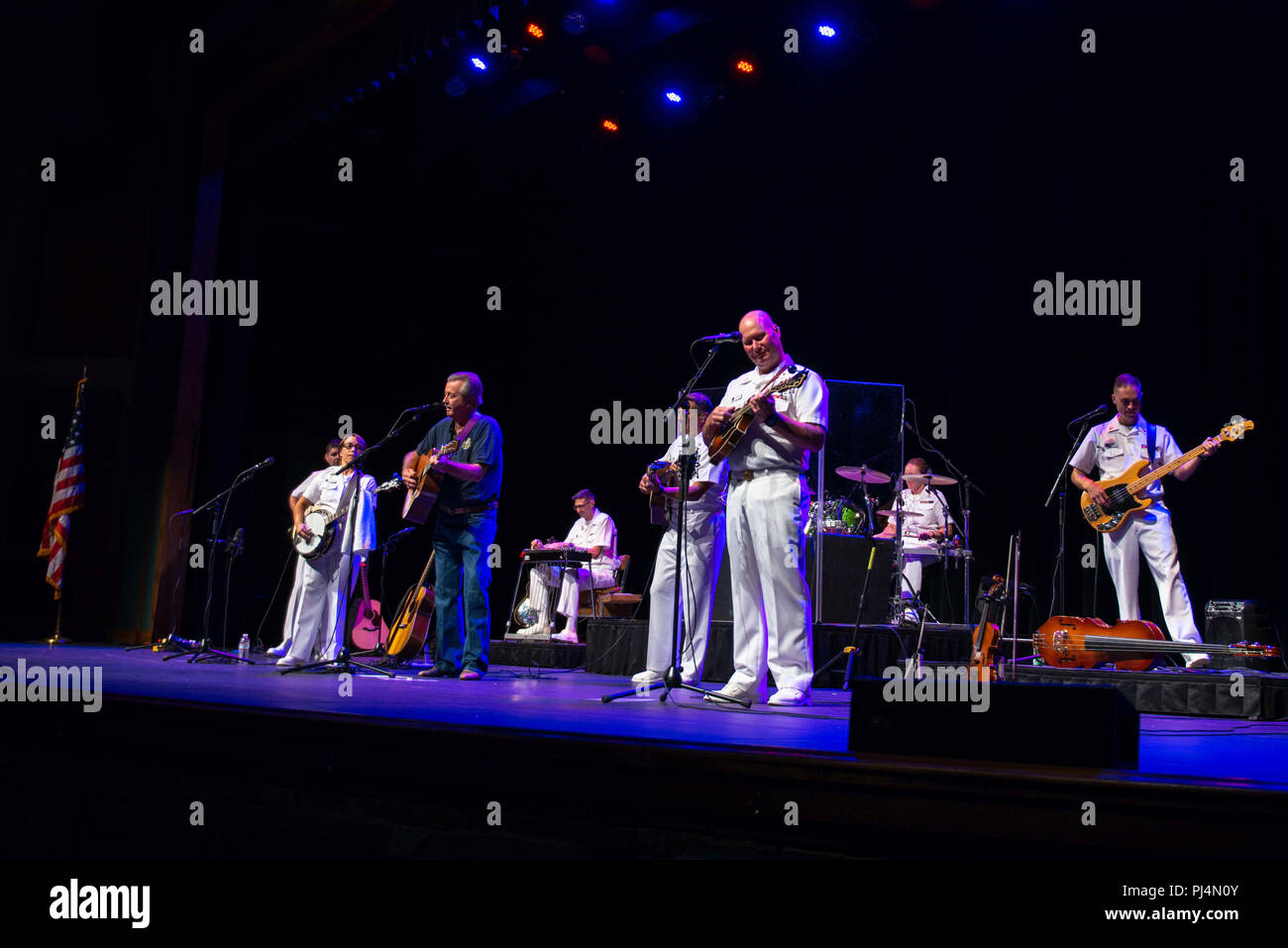 180830-N-NW255-1011 FRANKLIN, N.C. (Aug. 30, 2018) The U.S. Navy Band Country Current performs for a packed house at the Smoky Mountain Center for the Performing Arts,  joined by a former band member, retired Musician 1st Class Ben Winter. Country Current is on a 1,600 mile tour through Virginia, North Carolina, Georgia and Florida, which allows Navy musicians to entertain audiences in parts of the country that don't often get to see the Navy at work. (U.S. Navy photo by Senior Chief Musician Melissa Bishop/Released) Stock Photo