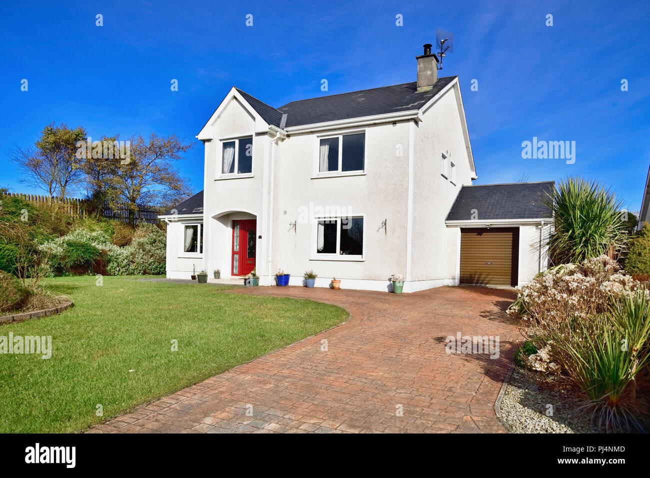 Ireland, County Sligo, Carney, suburban detached house with green lawn. - Stock Image