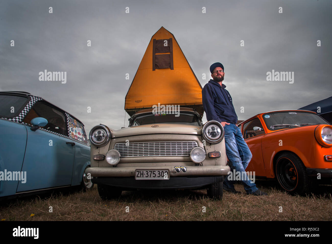 Andreas Leibezeit with his 1986 P601 Trabant and original DDR Tent attachment. - Stock Image