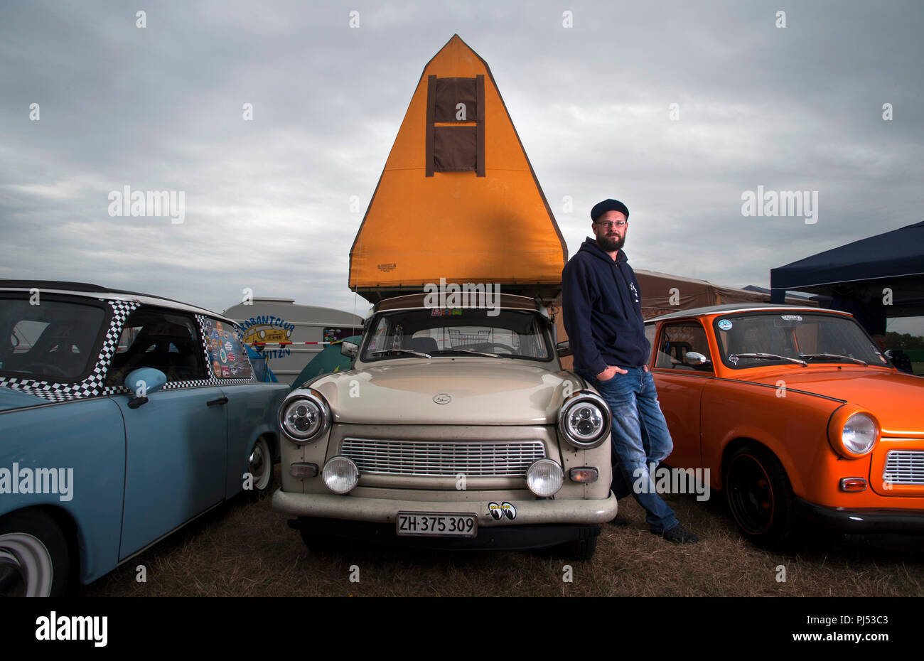 Andreas Leibezeit with his 1986 P601 Trabant and original DDR Tent attachment. Stock Photo