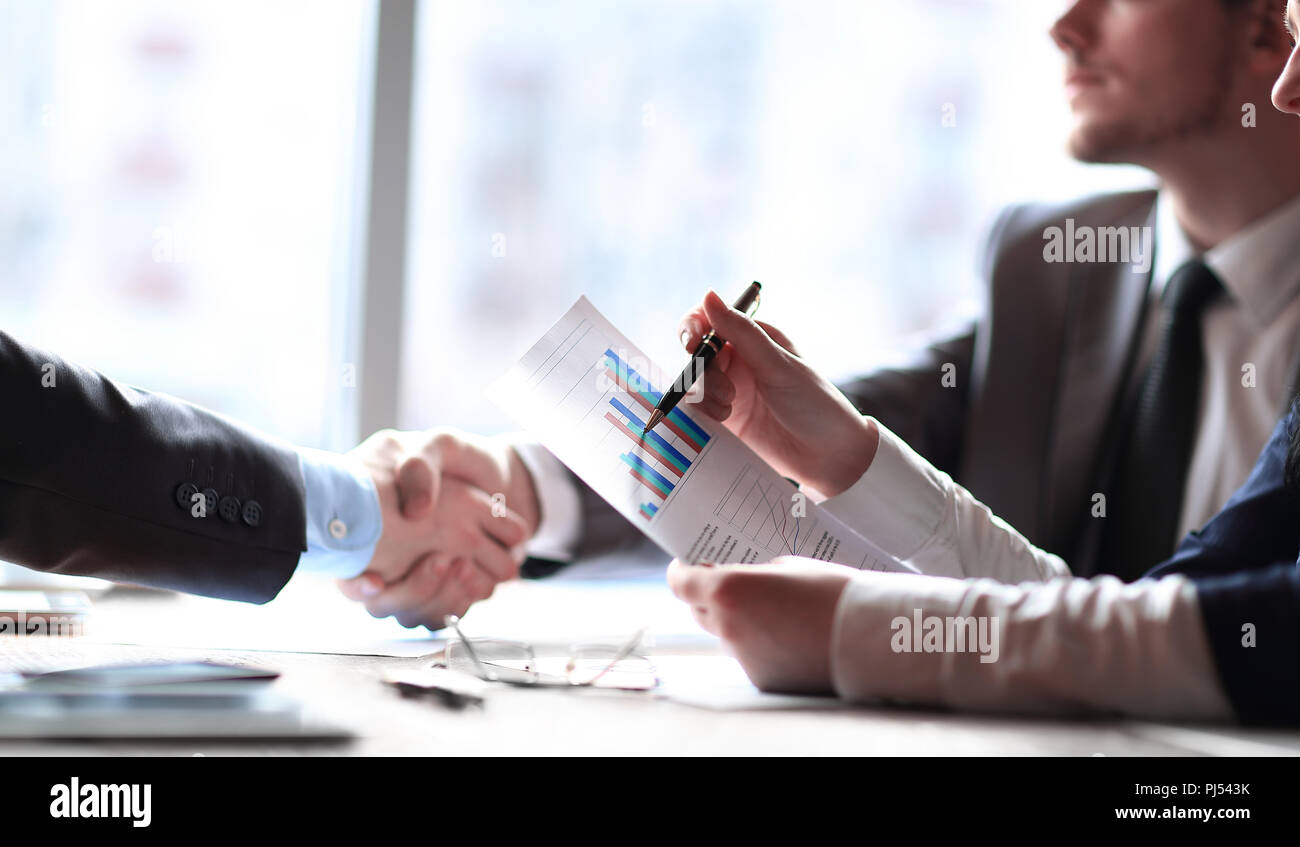 close up.business partners at the Desk in the office. - Stock Image