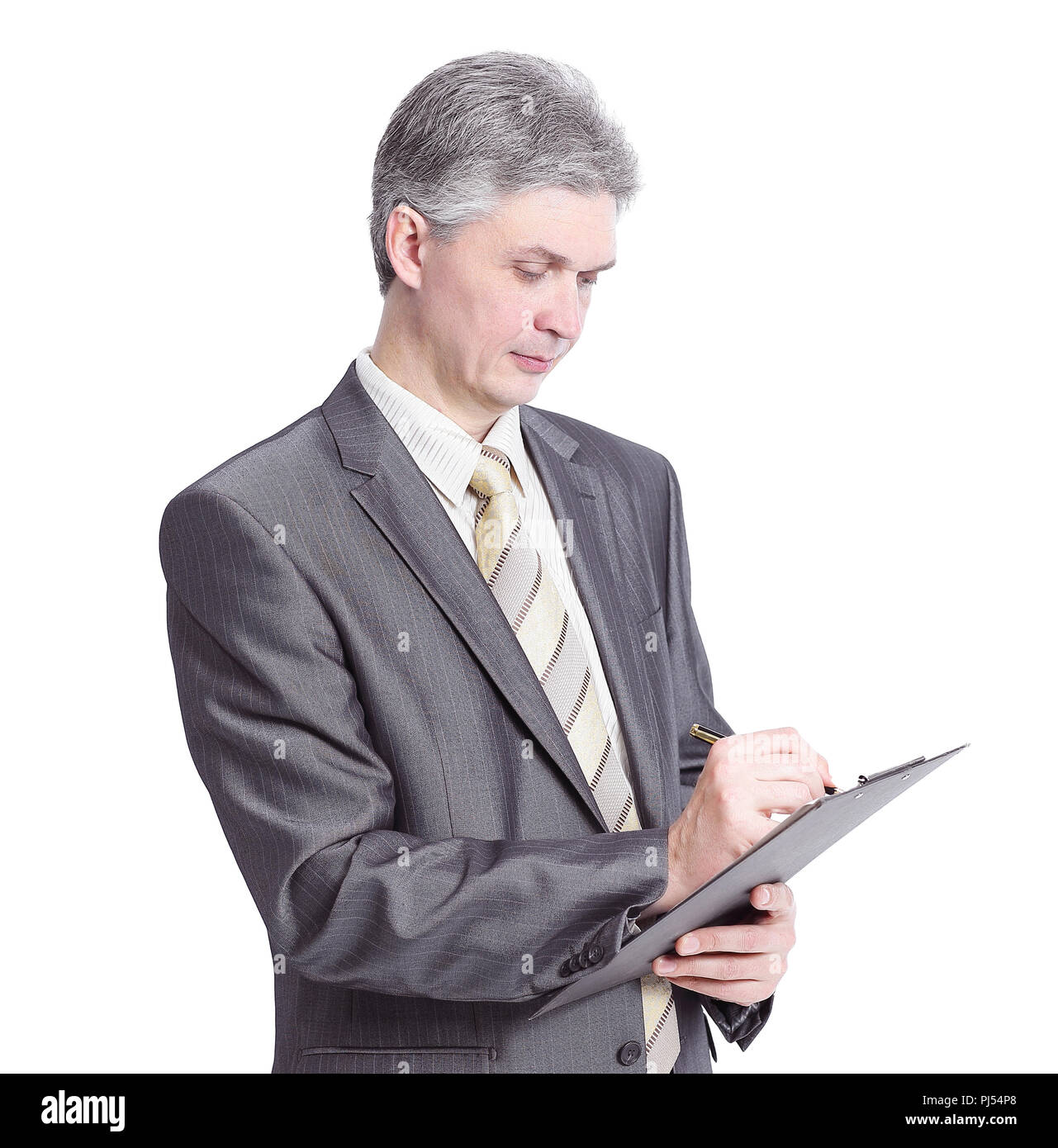 confident businessman writing in appointment book. - Stock Image
