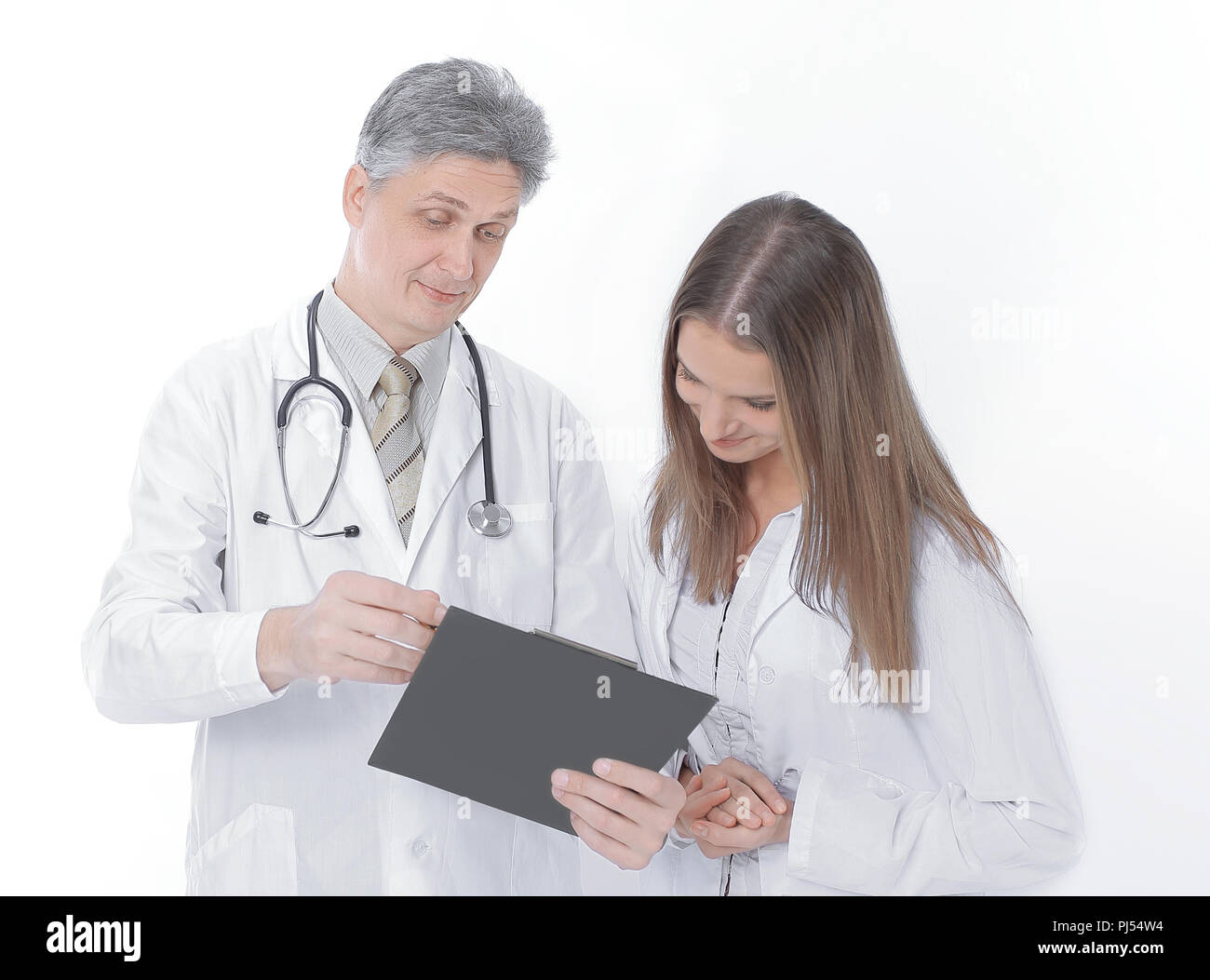 Woman doctor reviewing xrays with colleague.isolated on a white - Stock Image