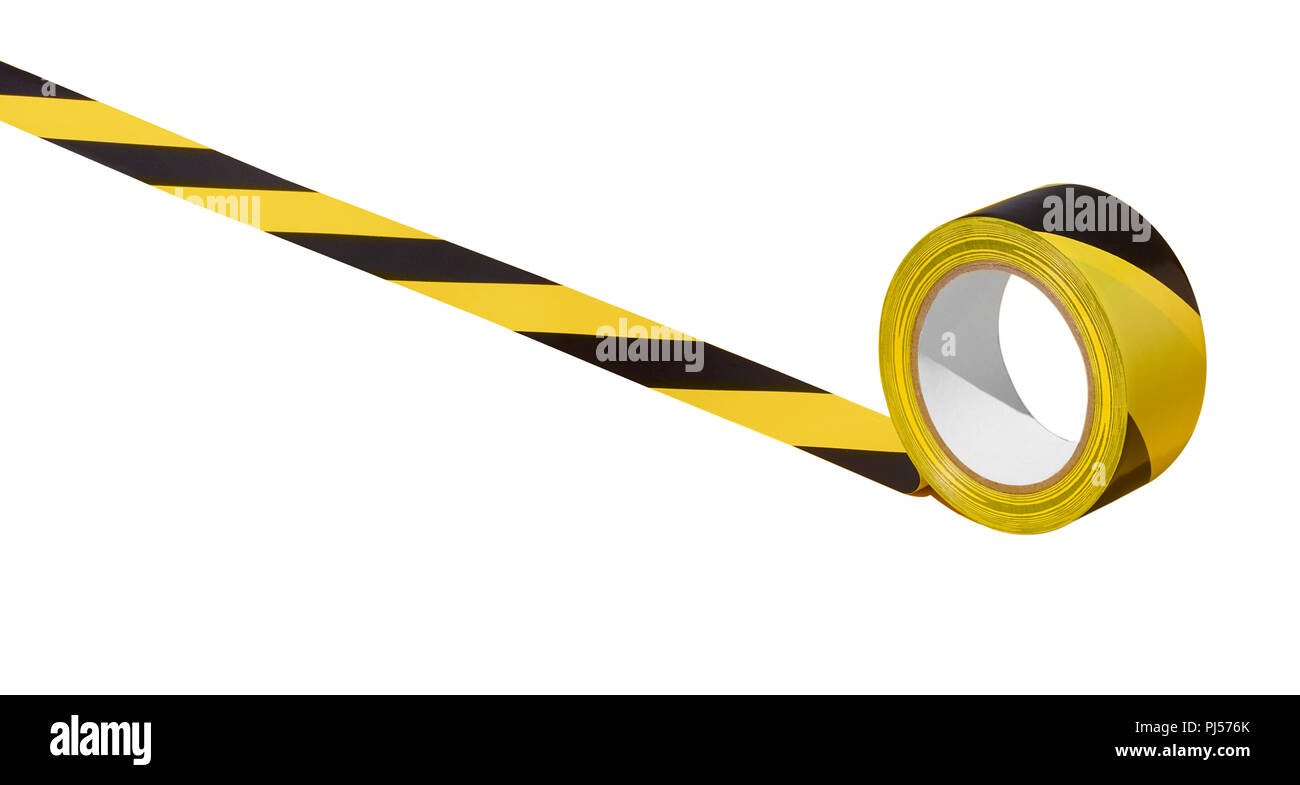 An unraveling roll of hazard tape - Stock Image