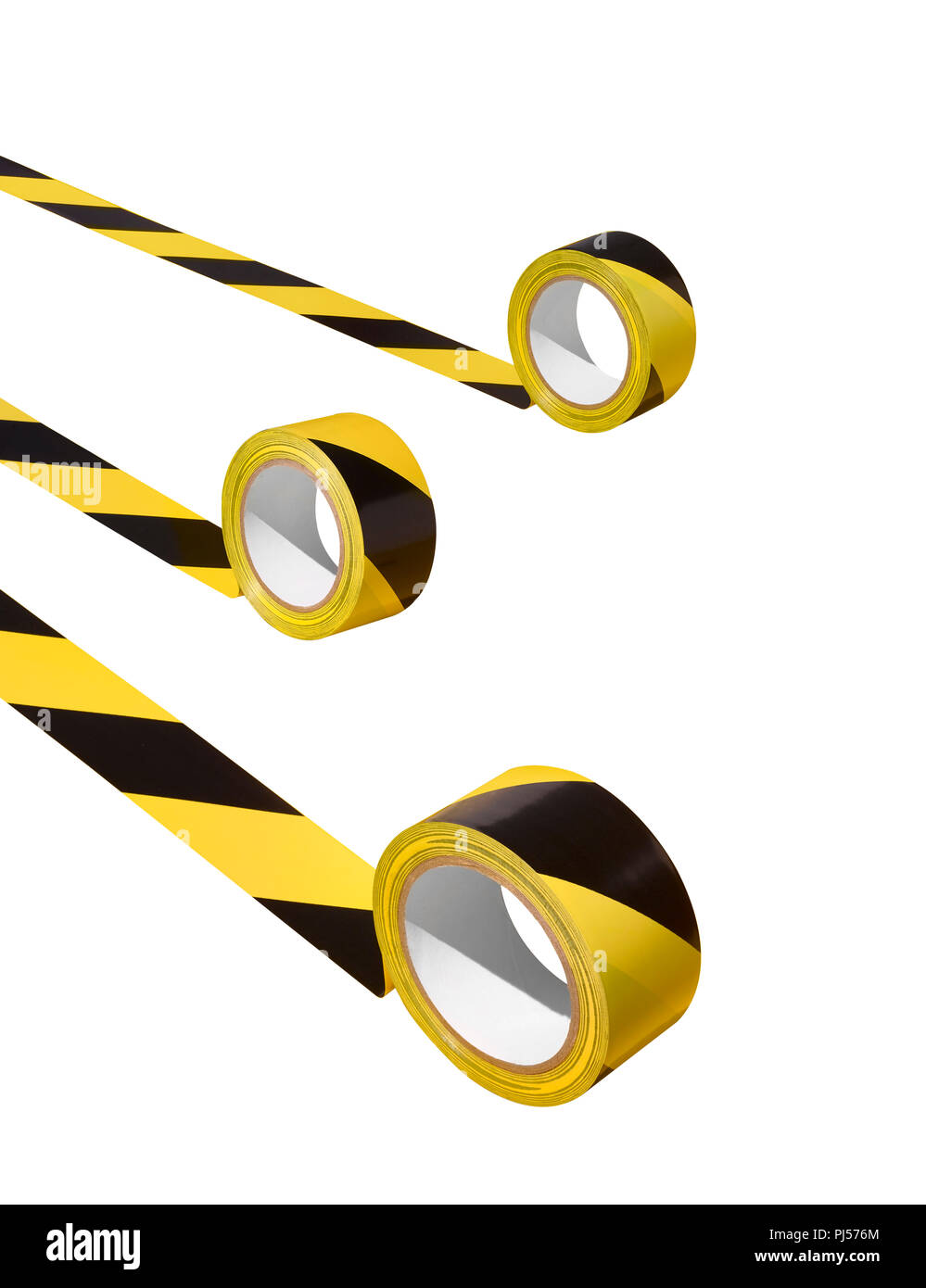Three unraveling rolls of hazard tape Stock Photo