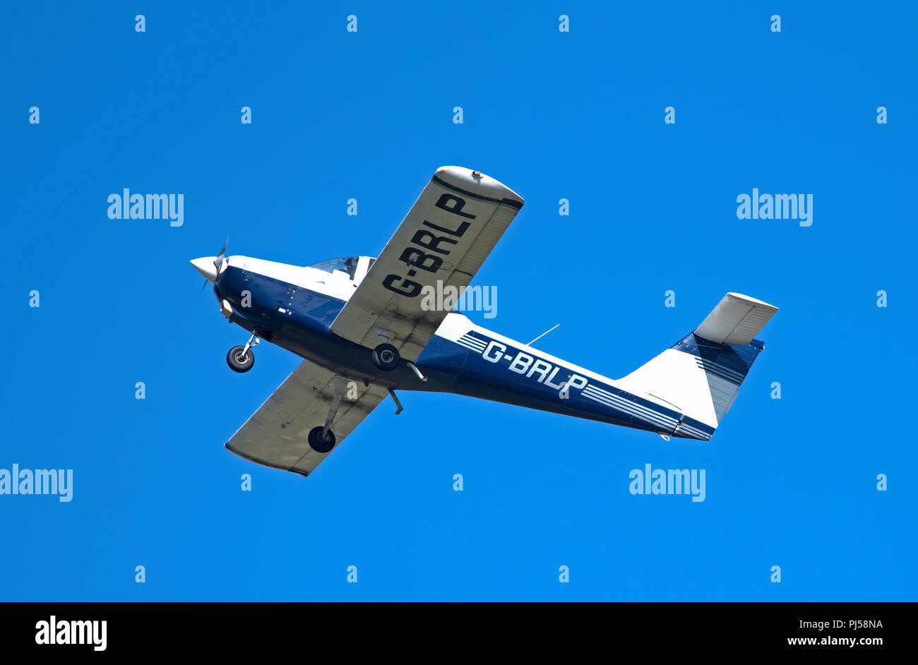 A tomahawk PA38-112 ON A Flying lesson practising touch and go circuits  at Inverness Airport in the North of Scotland. - Stock Image