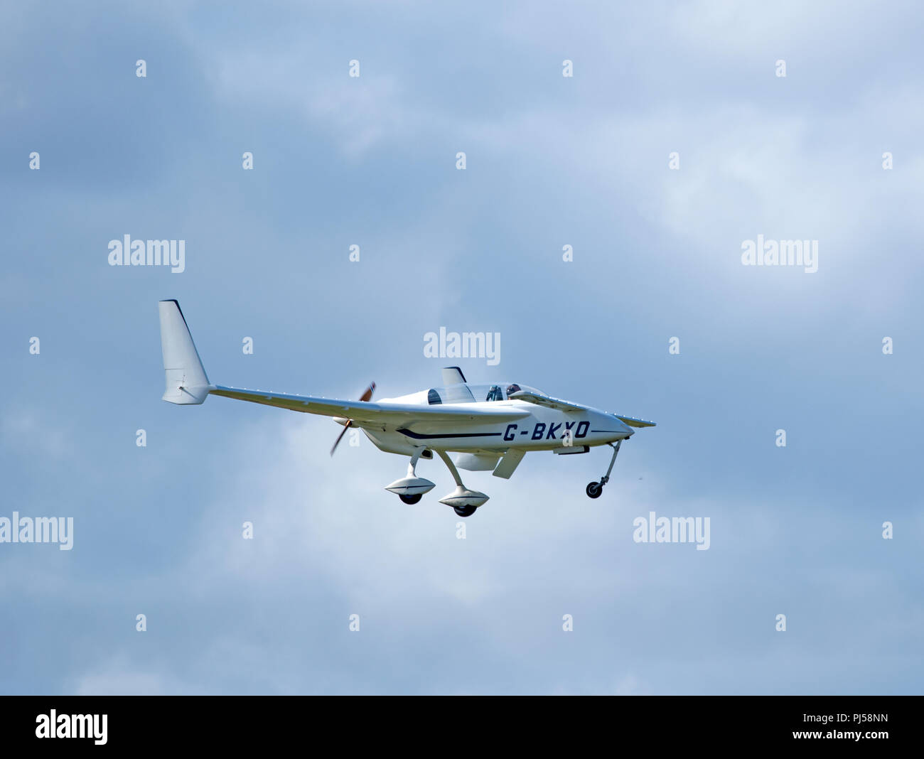 A Model 61 Long EZ home built aircraft from the Rutan factory Design in the USA departing from Inverness, Scotland. - Stock Image