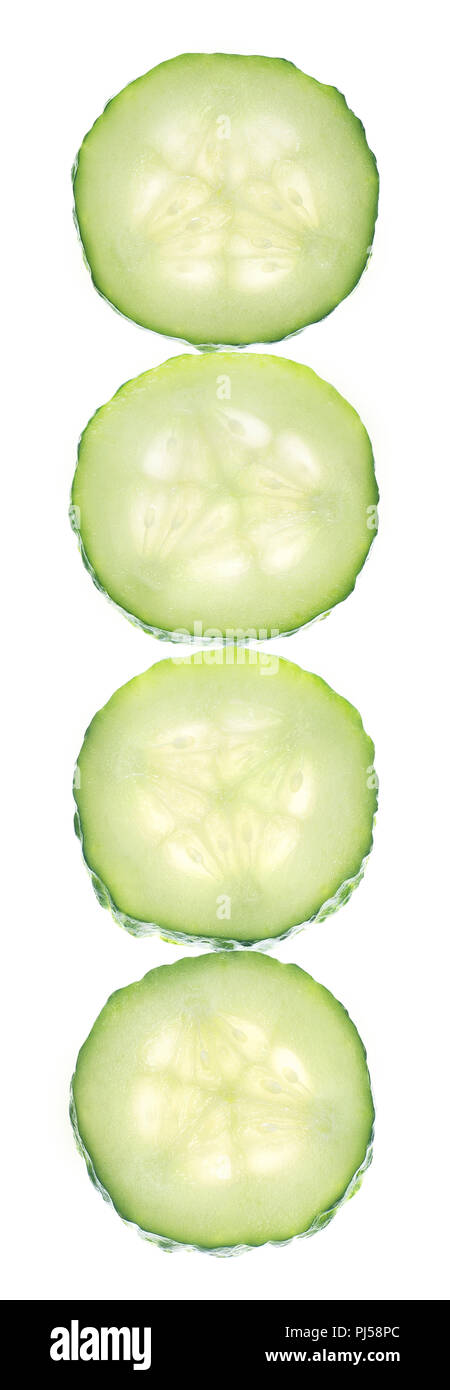 Transparent vertical cucumber slices isolated on white background as cosmetics package design element - Stock Image
